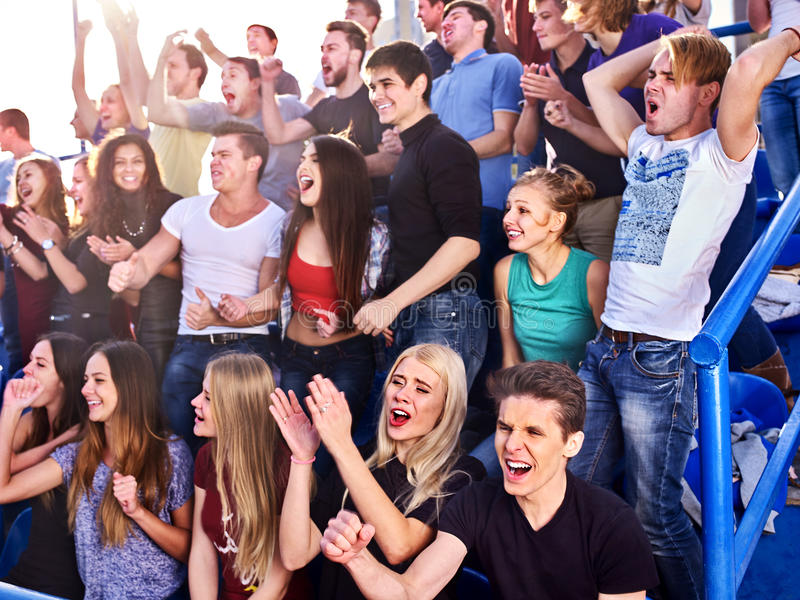 Sport fans clapping and singing on tribunes. Sport injoying group fans clapping and crying on tribunes stock images