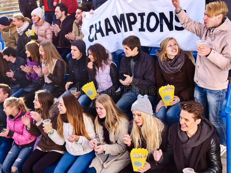 Sport fans holding champion banner on tribunes. Winter weather. Sport fans holding champion banner and singing on tribunes. Group people. Large group people and stock images