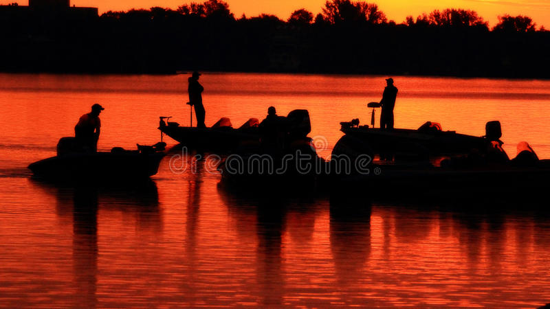 Download Sport Fisherman And There Boats At Sunrise Stock Photo - Image: 26696480