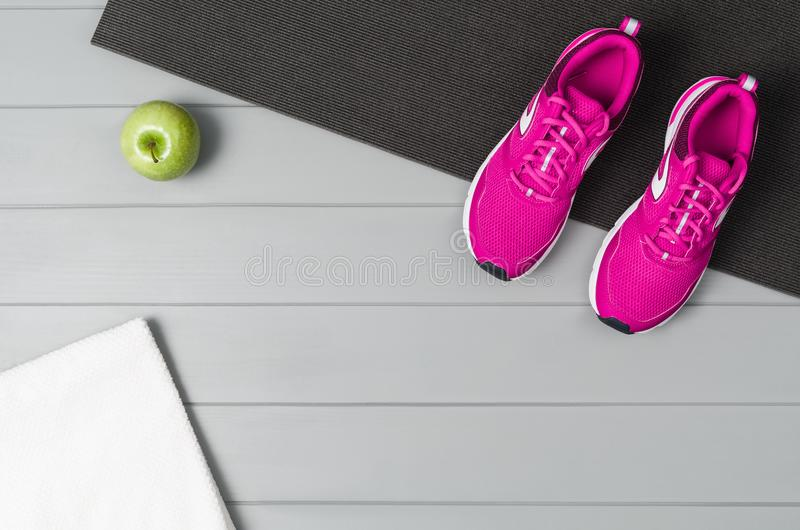 Sport fitness accessories on wooden background mock up, top view royalty free stock image