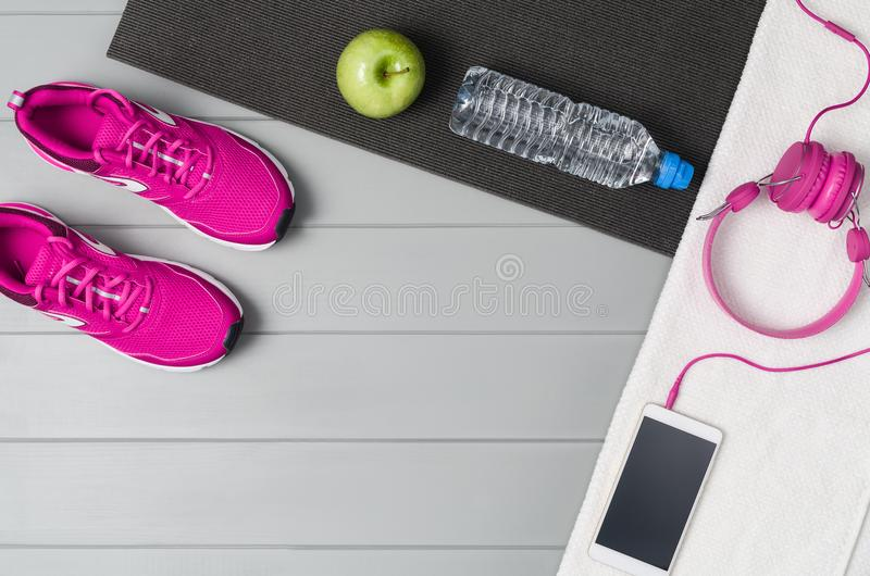 Sport fitness accessories on wooden background mock up, top view stock photo