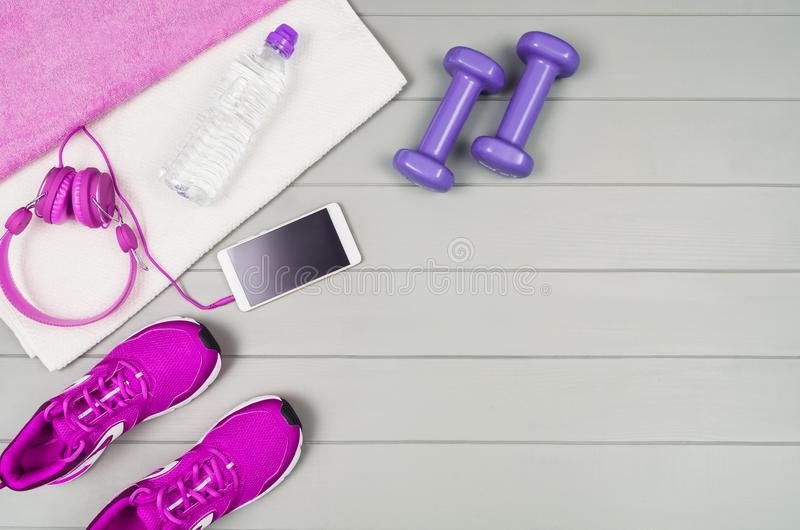 Sport fitness accessories on wooden background mock up, top view stock image