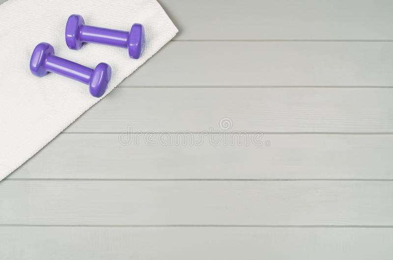 Sport fitness accessories on wooden background mock up, top view royalty free stock images