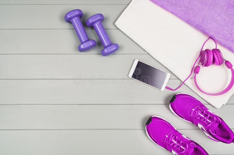 Sport fitness accessories on wooden background mock up, top view royalty free stock photography