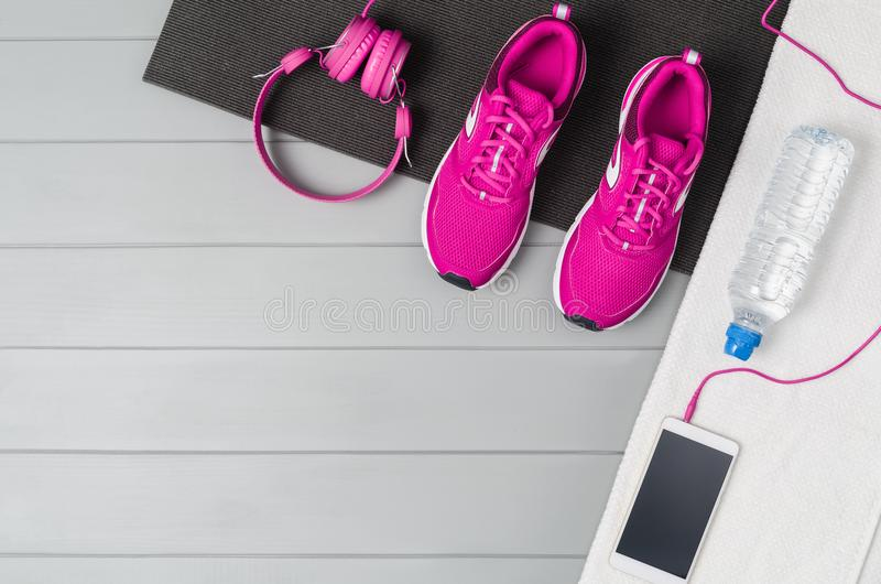 Sport fitness accessories on wooden background mock up, top view royalty free stock photo
