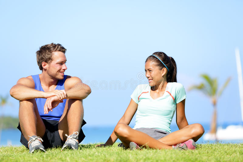 Sport fitness couple relaxing after training stock photos