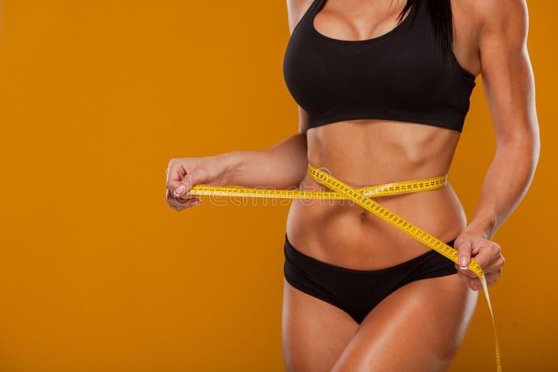 Sport, fitness en dieetconcept - sluit omhoog van stock afbeeldingen