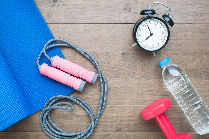 Sport and fitness equipments with alarm clock and water royalty free stock photo