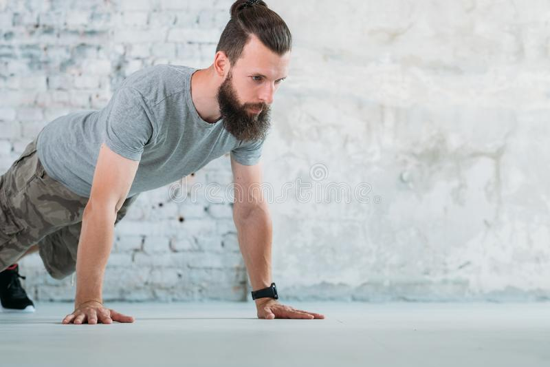 Sport fitness training man push ups chest muscles. Sport fitness and training. man doing push ups. chest muscles and biceps development royalty free stock images