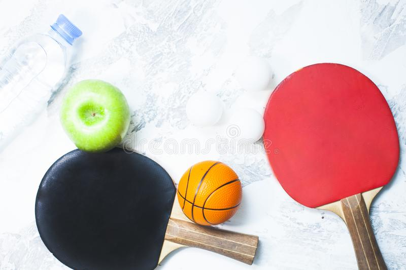 Sport fitness, weight loss concept. Ping pong racket, balls on white wooden background. Vintage retro instagram filter stock photos