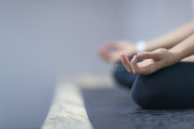 Sport Fitness Woman Doing Yoga Exercises In Gym, Closeup Young Healthy Girl Sitting Lotus Pose. Woman Doing Yoga Exercises In Gym, Closeup Sport Fitness Girl stock image