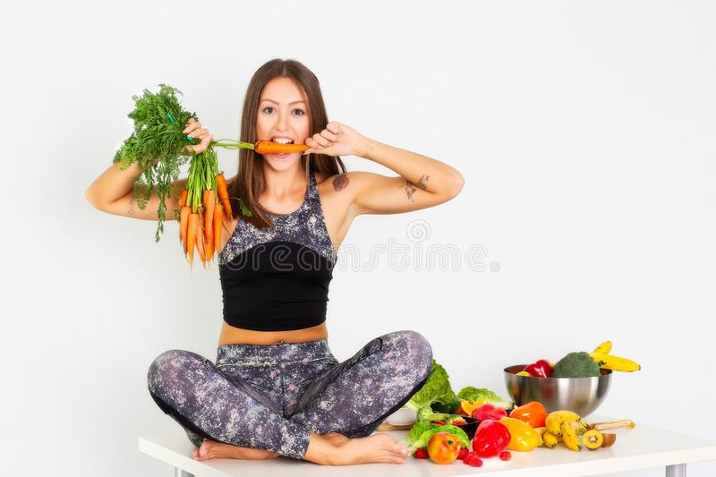 Sport fitness woman, fitness woman leggings,Young beautiful girl with long brown hair in a sports top and tights with fruits and. Sport fitness woman leggings royalty free stock photo