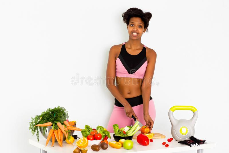 Sportive fitness, Black woman ,Home Fitness Black Woman. Sport fitness woman leggings,Young beautiful girl with with sports top and tights with fruits and royalty free stock image