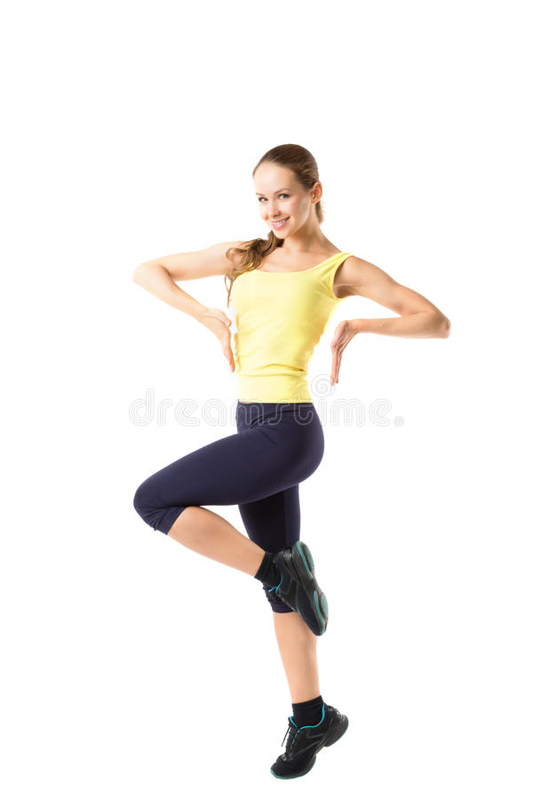 Sport fitness woman, young healthy girl doing exercises, full length portrait. royalty free stock photo