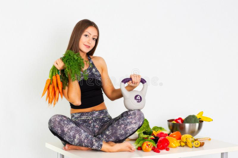 Sport fitness womsport fitness woman leggings,Young beautiful girl with long brown hair in a sports top and tights with fruits and. Sport fitness woman leggings royalty free stock image