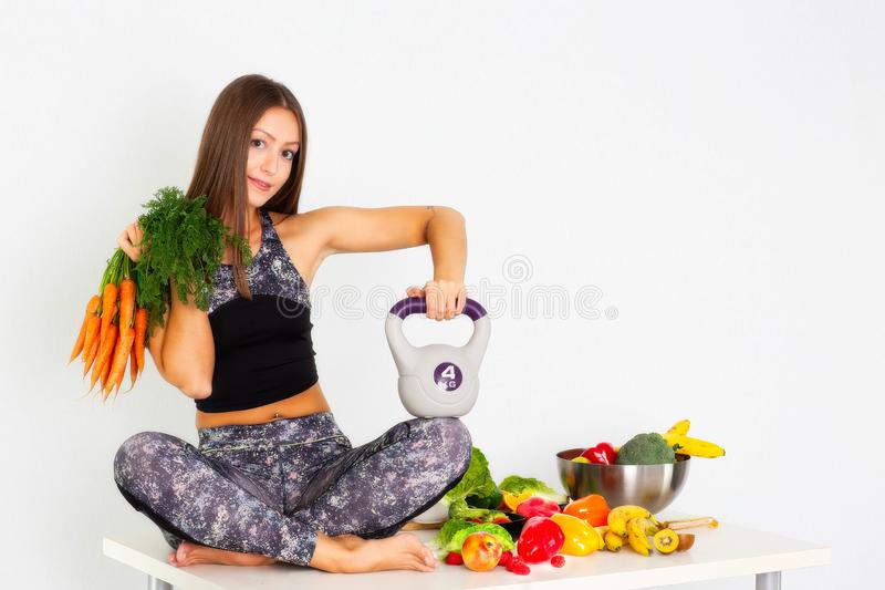 Sport fitness womsport fitness woman leggings,Young beautiful girl with long brown hair in a sports top and tights with fruits and. Sport fitness woman leggings royalty free stock photos