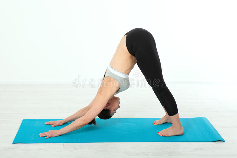 Sport. Fitness Yoga woman. Beautiful middle-aged woman doing yoga poses. Concept people are workout in yoga, training in. Sports clothes isolated stock photo