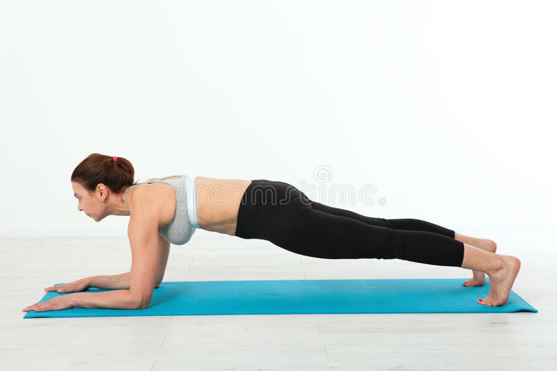 Sport. Fitness Yoga woman. Beautiful middle-aged woman doing yoga poses. Concept people are workout in yoga, training in. Sports clothes stock photography