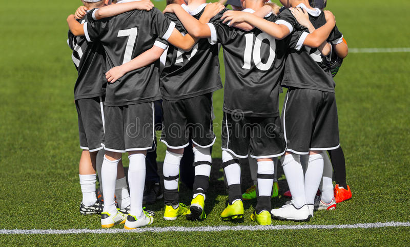 The sport football team with coach; Group photo; Children sports club stock photography