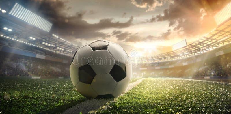 sport Fußballkugel auf Stadion lizenzfreie abbildung