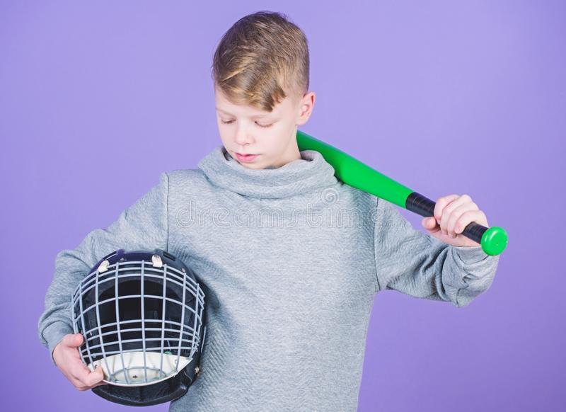 Sport game. Gym workout of teen boy. Baseball bat and helmet. Success. Childhood activity. Fitness brings health and. Energy. child sportsman. Sport tools - bat royalty free stock photo