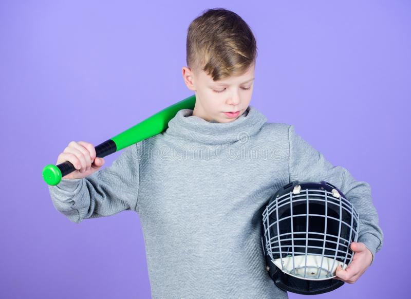 Sport game. Gym workout of teen boy. Baseball bat and helmet. Success. Childhood activity. Fitness brings health and. Energy. child sportsman. Sport tools - bat royalty free stock image