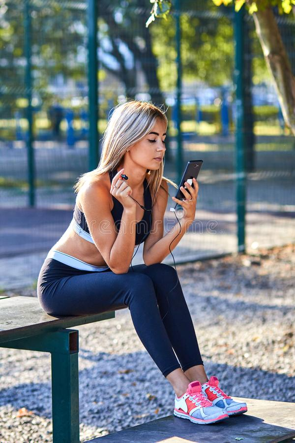 Sport girl. The girl is doing fitness exercises. Beautiful young sports woman doing exercises. A woman is training on a sports fie. Ld. Young beautiful girl in royalty free stock photos