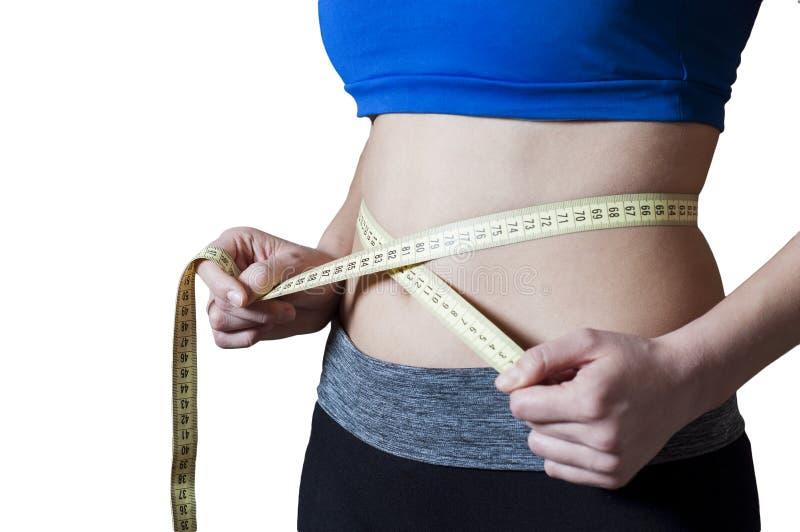 Sport girl measured waist stock photo