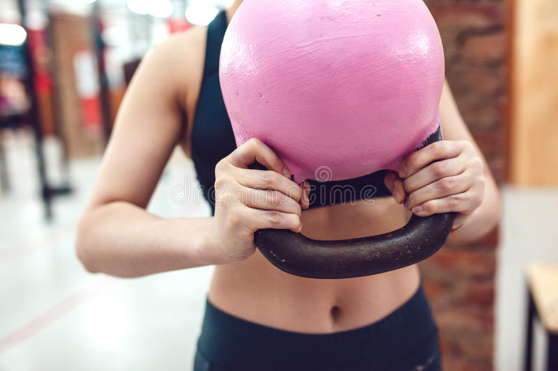 Sport girl is preparing to exercise with kettlebel stock image