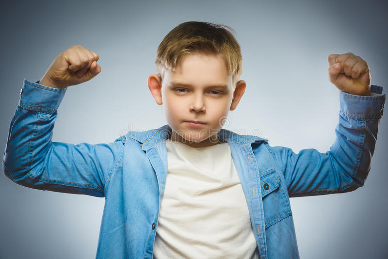 Sport Handsome Boy. Strong serious kid showing his hand biceps muscles stock photo