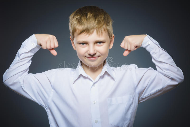 Sport Handsome Boy. Strong serious kid showing his hand biceps muscles royalty free stock image