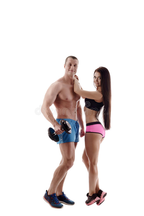 Sport and healthy life. Couple posing at camera. Sport and healthy life. Attractive couple posing at camera royalty free stock images