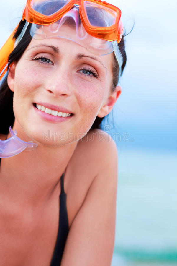 Sport holiday. Smiling holiday sports vacation woman smiling on the beach stock image