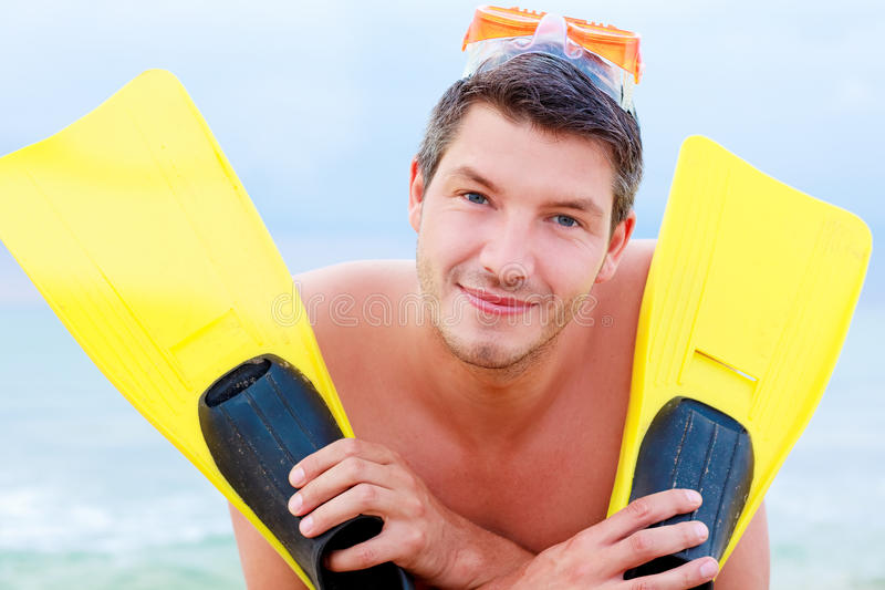 Sport holiday. Smiling holiday sports vacation man smiling on the beach royalty free stock photo