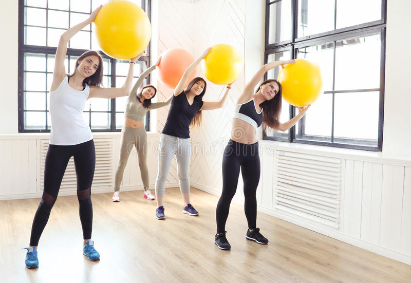 Sport indoor. Sport. Women exercise in the gym stock photo