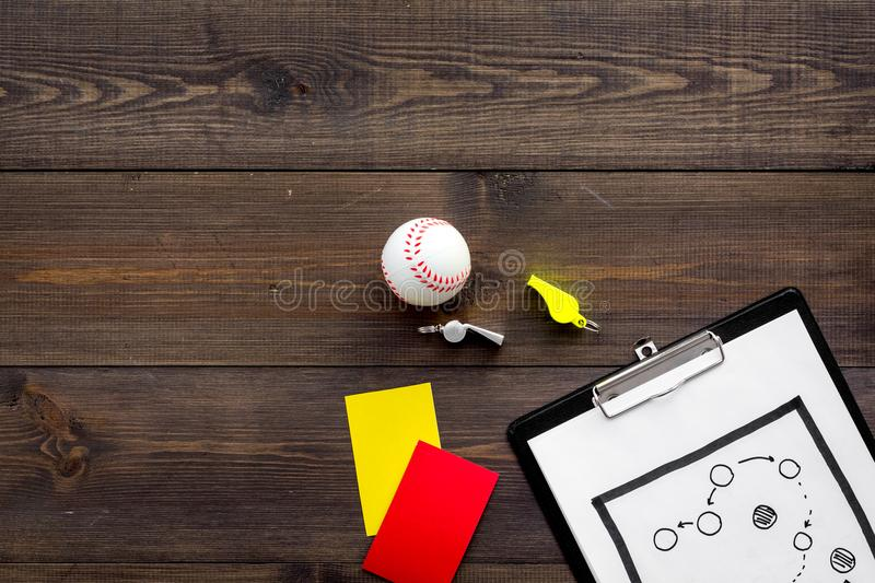 Sport judging concept. Baseball referee. Tactic plan for game, base-ball ball, red and yellow cards, whistle on wooden royalty free stock images