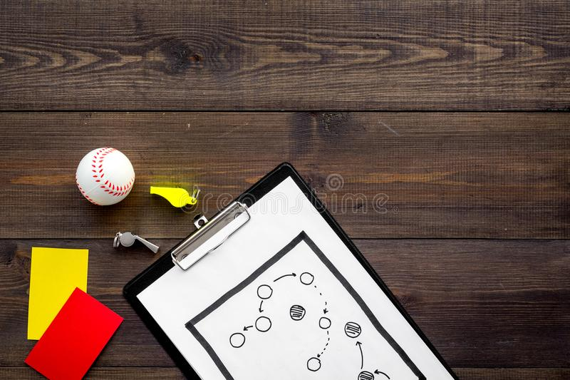 Sport judging concept. Baseball referee. Tactic plan for game, base-ball ball, red and yellow cards, whistle on wooden royalty free stock photography