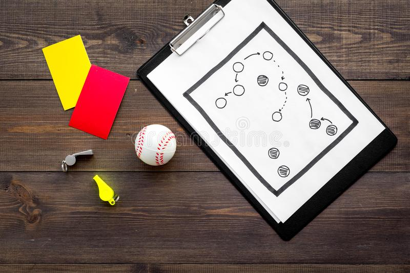 Sport judging concept. Baseball referee. Tactic plan for game, base-ball ball, red and yellow cards, whistle on wooden stock photography