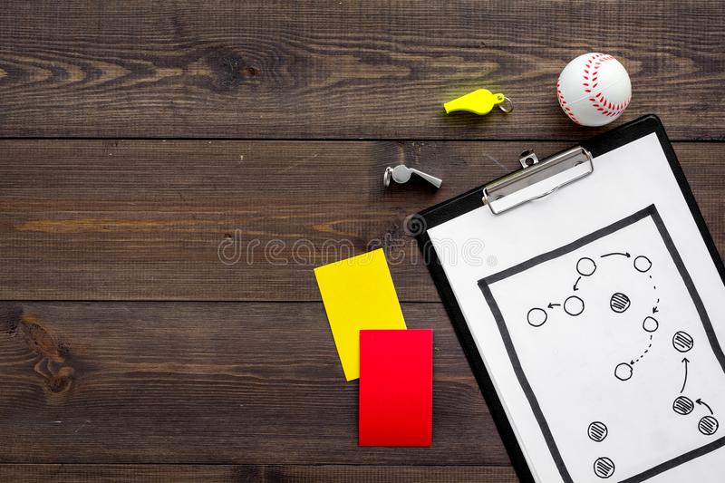 Sport judging concept. Baseball referee. Tactic plan for game, base-ball ball, red and yellow cards, whistle on wooden royalty free stock image