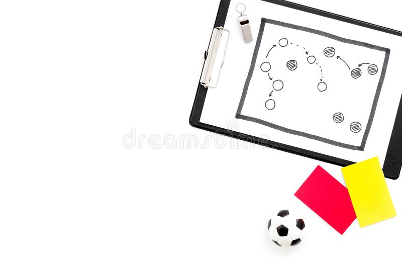 Sport judging concept. Soccer referee. Tactic plan for game, football ball, red and yellow cards, whistle on white royalty free stock photography