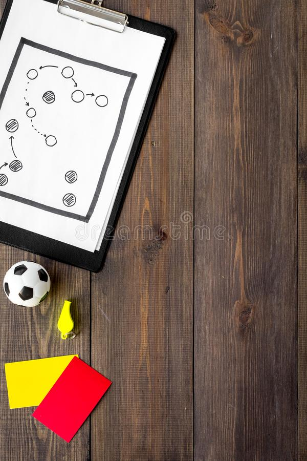 Sport judging concept. Soccer referee. Tactic plan for game, football ball, red and yellow cards, whistle on wooden stock photos