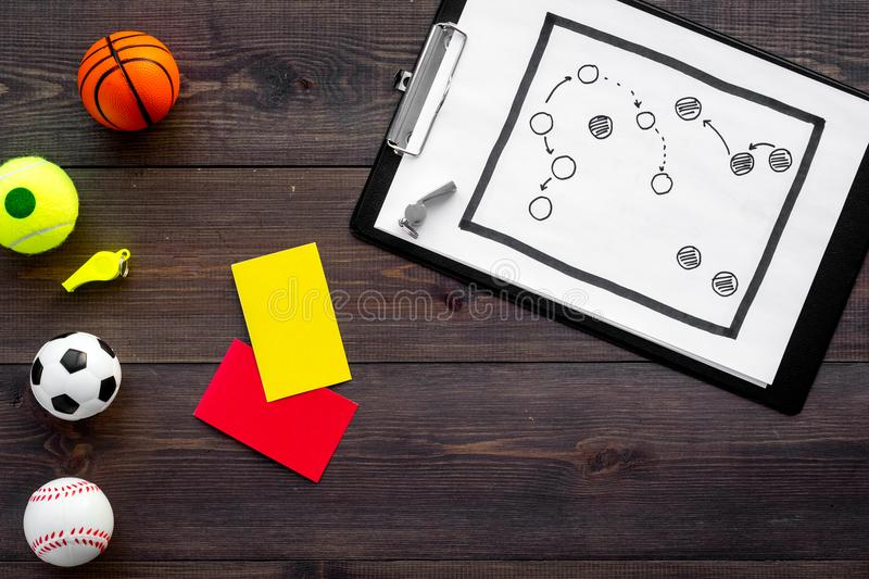 Sport judging concept. Sport game referee. Tactic plan for game, balls, red and yellow cards, whistle on wooden stock photos