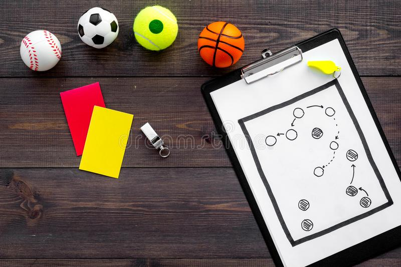 Sport judging concept. Sport game referee. Tactic plan for game, balls, red and yellow cards, whistle on wooden stock photography