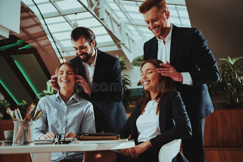 Men do Head Massage for Girls in Office. Sport Lifestyle. Healthcare of Business People. Yoga Practice. Women is Meditating. Girls Relax on Workplace. Women stock image