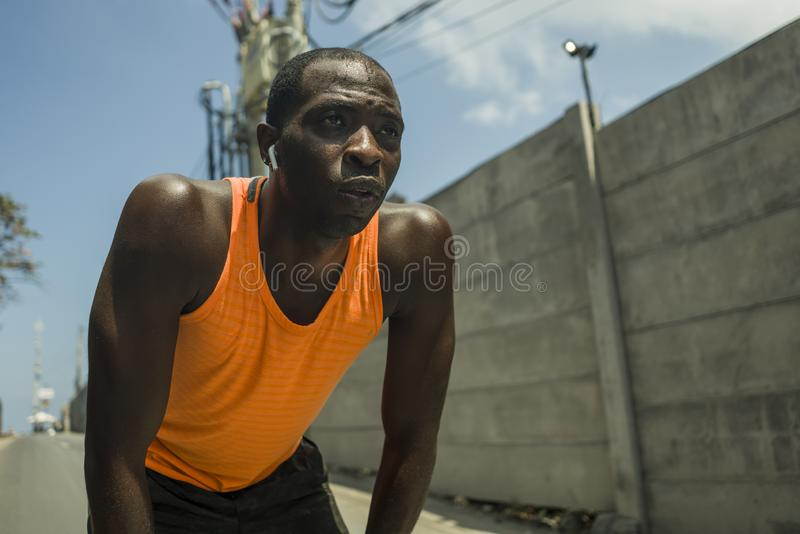 Sport lifestyle portrait of tired and exhausted black badass looking African American man breathing cooling off after hard running. Workout in fitness sacrifice royalty free stock photo