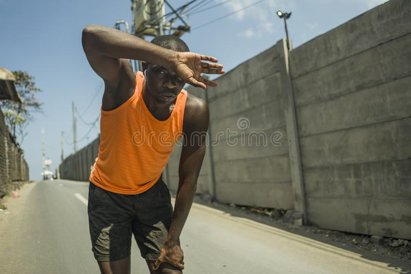 Sport lifestyle portrait of tired and exhausted black badass looking African American man breathing cooling off after hard running. Workout in fitness sacrifice royalty free stock images