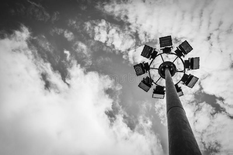 Sport light post with cloud and sky background in grey scale tone stock photo
