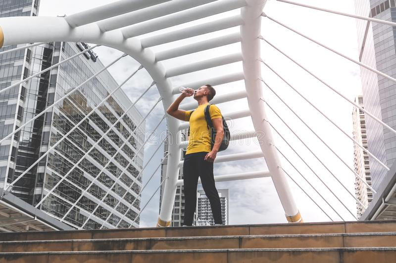 Sport Man drinking water in a break from his work out stock photos