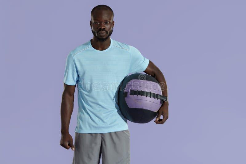Sport man in fashion sportswear with med ball studio portrait royalty free stock photos