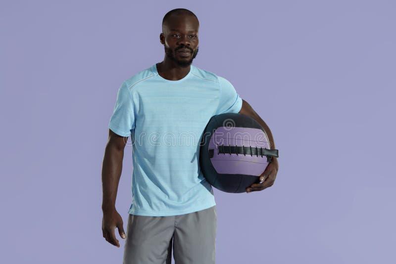 Sport man in fashion sportswear with med ball studio portrait royalty free stock photo
